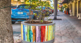 Image of a sidewalk planter covered in mosaic tiles